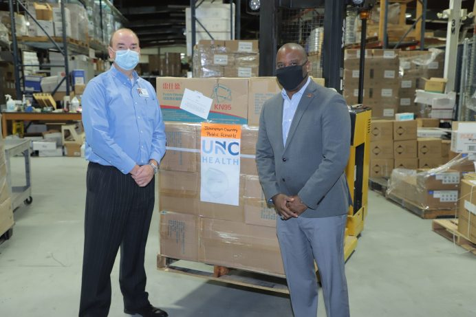 Johnston Health has donated 10,000 masks to Johnston County Public Schools. From left, Johnston Health CEO Tom Williams joins Johnston County Public Schools Superintendent Dr. Eric C. Bracy at the schools' distribution warehouse to check out the delivery.