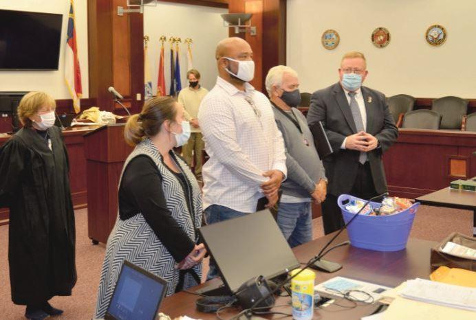 Two Veteran's Treatment Court graduates join team members in singing 'As the Army Goes Rolling Along.' From left, are Judge Jacquelyn Lee, program manager Genevieve Winderweedle, Stephen Doust, Duke Radford and program director Mark Teachy. Dunn Daily Record Photo