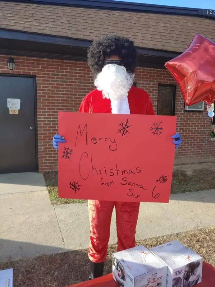 Smithfield Town Councilman Marlon Lee dressed as Santa Claus