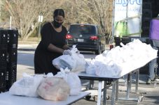 School Nutrition Supervisor Twana Johnson helps distribute Holiday Meal Kits at Smithfield-Selma High.