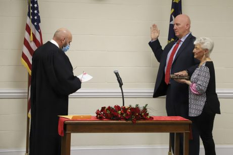 Mike Wooten takes his oath from Superior Court Judge Tom Lock. JCPS Photo
