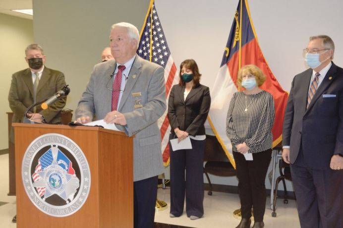 Harnett County Sheriff Wayne Coats speaks during a Monday afternoon press conference as Det. John Hawley, Rep. Howard Penny, Ann Ross, Lesli Kaufman and Sen. Jim Burgin look on. Dunn Daily Record Photo