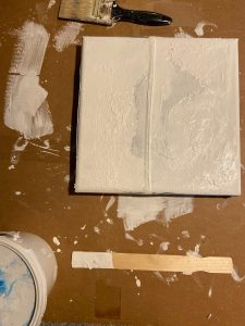 Layers of gesso on stretched blue jeans