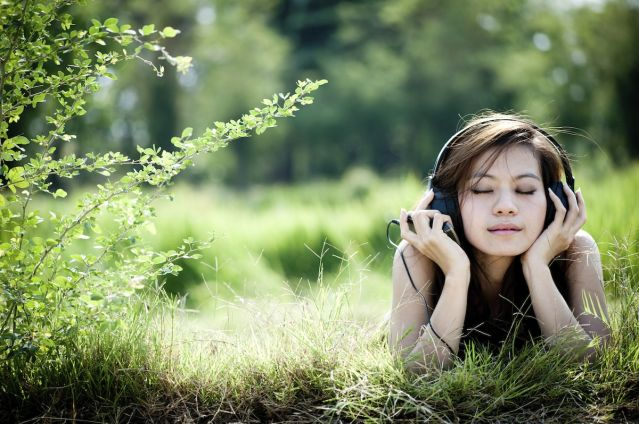 listening-to-music-relaxing-meadow