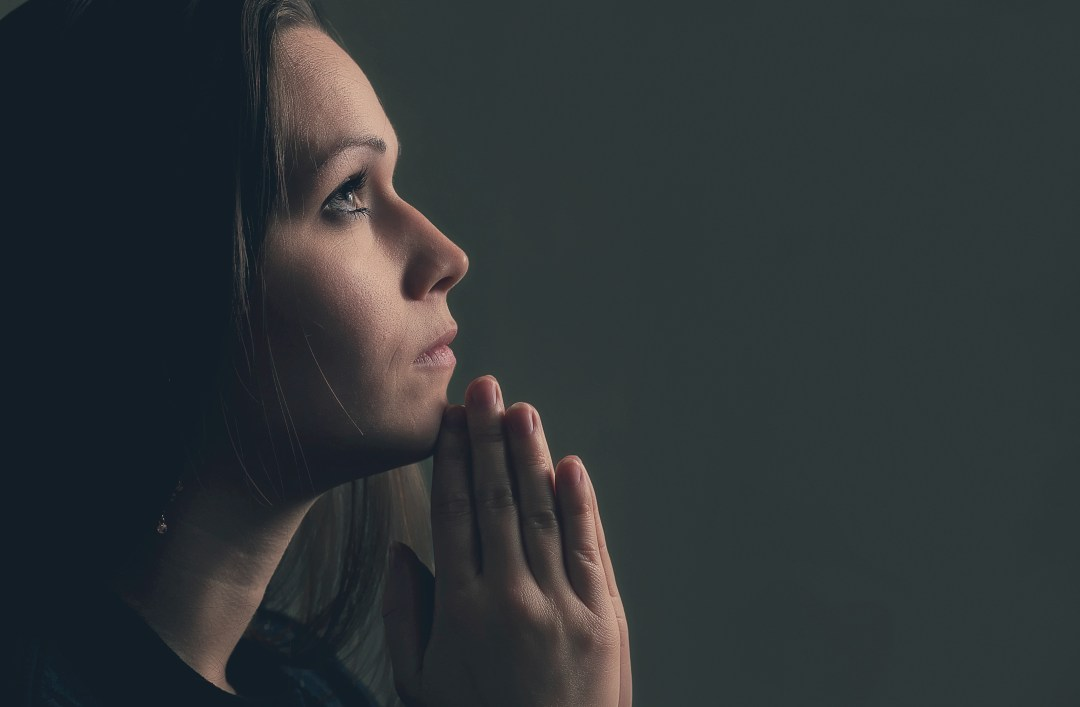 Woman praying alone