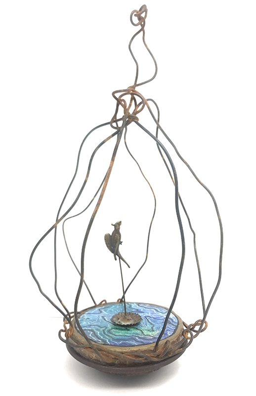 figurative sculpture of bird in cage with water on floor
