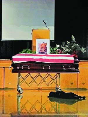 Navy SEAL Jon Tumilson's dog, Hawkeye, at Tumilson's funeral