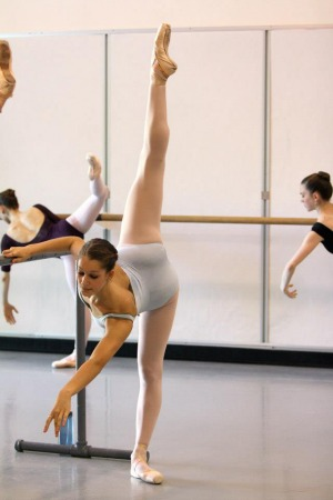 Ballet dancer doing standing splits