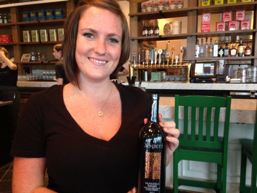 Waitress with bottle of wine