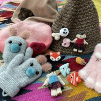 Felt in fashion...new brooches, gloves and friendly fuzzy feelings