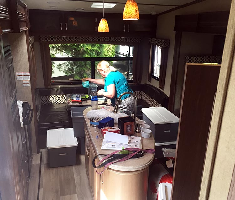 Moving into our Fifth Wheel to start our RV life. Over time we got most of the bits and pieces into organized and labeled bins. And when I say we, I mainly mean Maggie