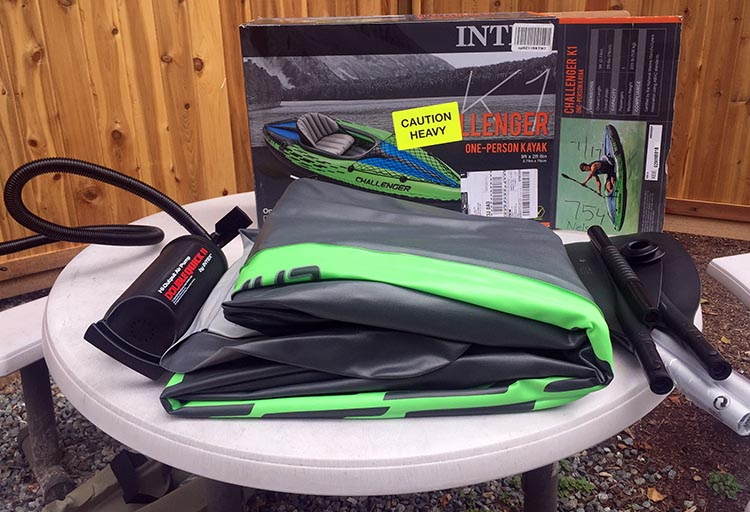 Review and Assembly of the Intex Challenger K1 Kayak – the Best Lightweight, Budget, Inflatable Kayak for RV Living. The box includes a carry bag; the kayak itself, which has two air chambers; two seat cushions (seat and back rest); a foot rest cushion; and a paddle which you clip together