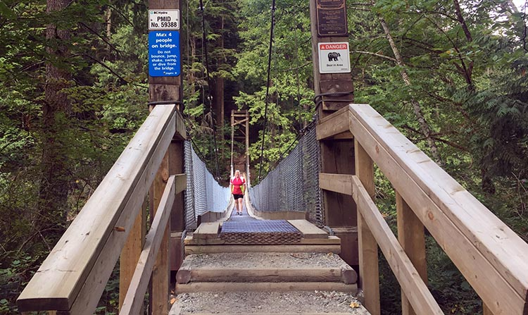 Review of Anmore Camp and RV Park, Near Vancouver. Here's Maggie on the suspension bridge over a narrow part of Buntzen Lake