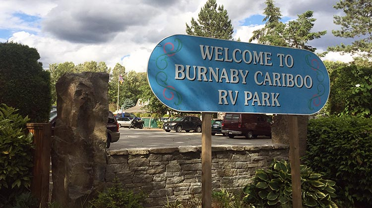 Review of the Burnaby Cariboo RV Park, Near Vancouver. There is a friendly Welcome sign outside the Burnaby Cariboo RV Park