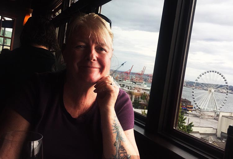 """What Can You Do When Your RV is Having Repairs? Our favorite Seattle restaurant was Lowell's, a seafood restaurant at Pike Place Market that has the amusing tagline, """"Almost classy since 1957."""" Here's Maggie, with the Seattle Big Wheel in the background"""