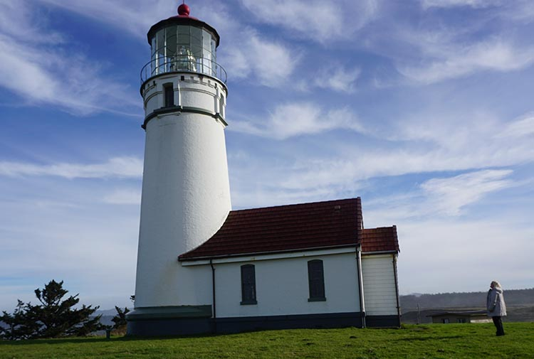 Our Experience of RV Camping at Beverley Beach and Humbug Mountain State Parks, Oregon Coast. Maggie admiring Cape Blanco Lighthouse