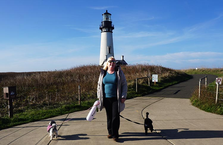 Our Experience of RV Camping at Beverly Beach and Humbug Mountain State Parks, Oregon Coast. Maggie and the dogs at Yaquina Head Lighthouse. Notice how Billy (on the right) is behaving well, while Ripley is attempting to walk in the opposite direction. Typical ...