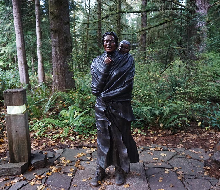 This is a statue of Sacagawea, a Shoshone Aboriginal woman who proved vital to the success of the expedition of Lewis and Clark