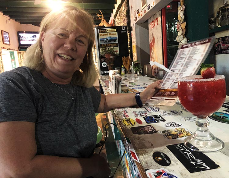 One of our group, Donna Braun, feeling happy at Rice and Beans Restaurant. hoto by fellow traveler Jim Braun