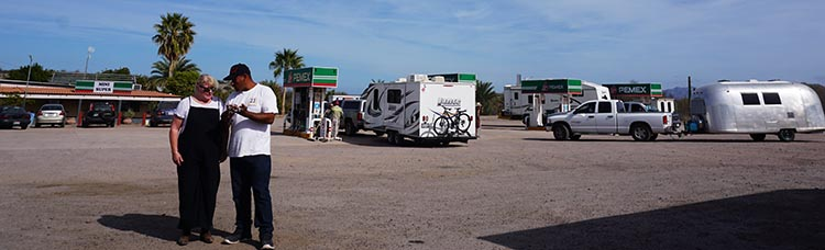 Day 5 of our RV Trip with Baja Winters: San Ignacio to Santispac Beach, Bahía de Concepción, Baja California Sur, Mexico. Here's a man trying to sell Maggie keychains at the Pemex three miles south of Mulege