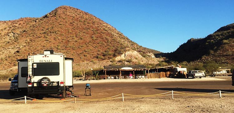 Day 5 of our RV Trip with Baja Winters: San Ignacio to Santispac Beach, Bahía de Concepción, Baja California Sur, Mexico. This photo shows how close our rig is to Armando's Restaurant on Santispac Beach