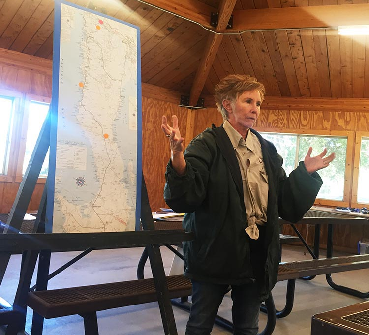 Wagon Master Becky of Baja Winters Travel Club, explaining our route at the group meeting in the pavilion at Potrero County RV Park