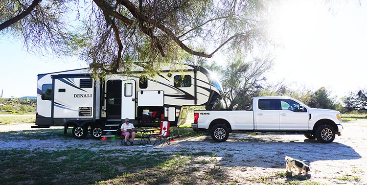 Maggie enjoying some well-earned relaxation time outside our rig at Rancho Santa Inez in Catavina