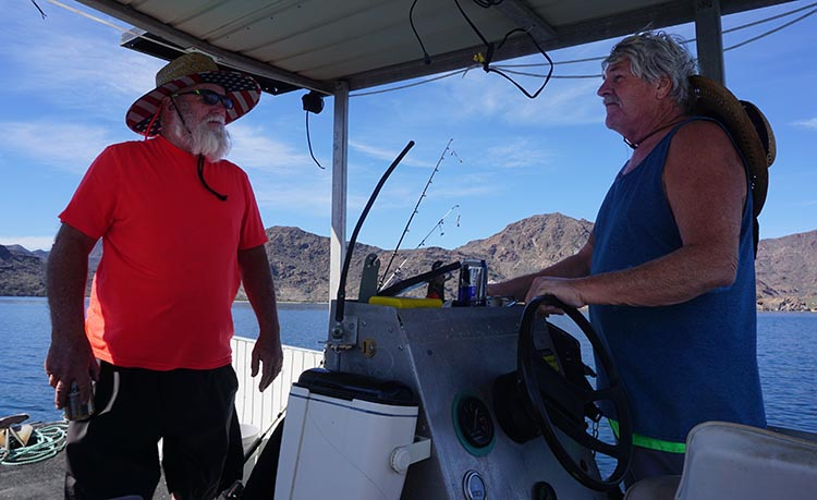 Here's Jerry piloting his boat, while Joe looks on. This was on the water in Bahia Concepcion, near Santispac Beach