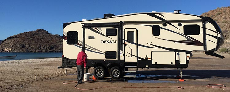 Here is one of the men cleaning our Denali fifth wheel