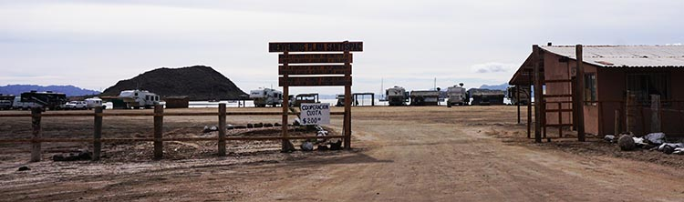 The entrance to Santispac Beach. The building on the right used to be an office, but is now closed down. You pay for your camping at Armando's Restaurant; if you don't, someone from the restaurant will come to your rig and request payment