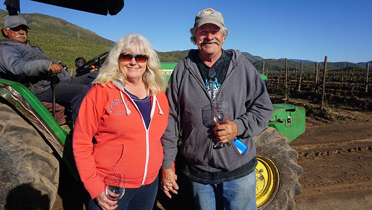 Fellow travelers Jerry and Kathy on the tractor tour at Santo Tomas