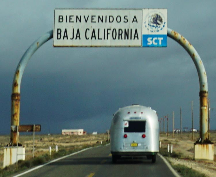 Our Return RV Caravan Trip from Baja California: Santispac Beach to Tecate. Then we were welcomed into Baja California by a sign. Photo by Nancy Bacciarini