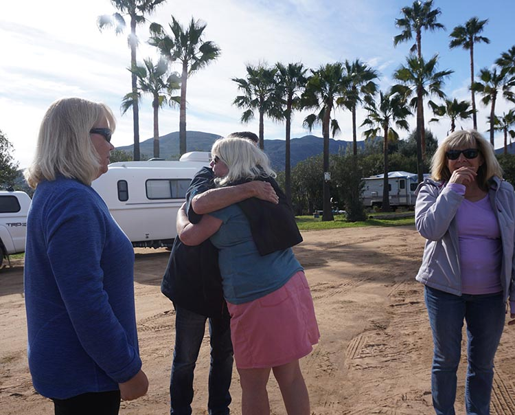 Exchanging hugs with our fellow travelers on the last morning