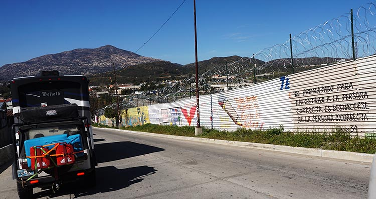 As we waited, we viewed the endless graffiti art on the border wall