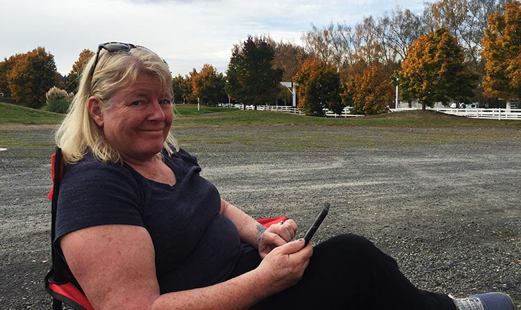 How to Get Free RV Camping with Harvest Hosts. Here I am, relaxing at one of our overnight stops, in the peaceful overflow parking at a golf club that participates in the Harvest Hosts program