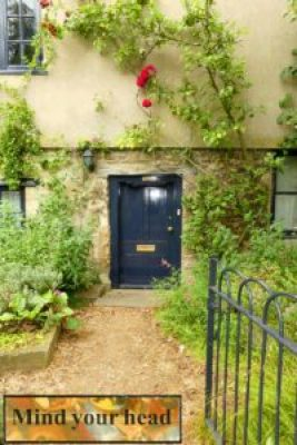 Trip - Cottage entry with low doorway. Inset: sign above doorway