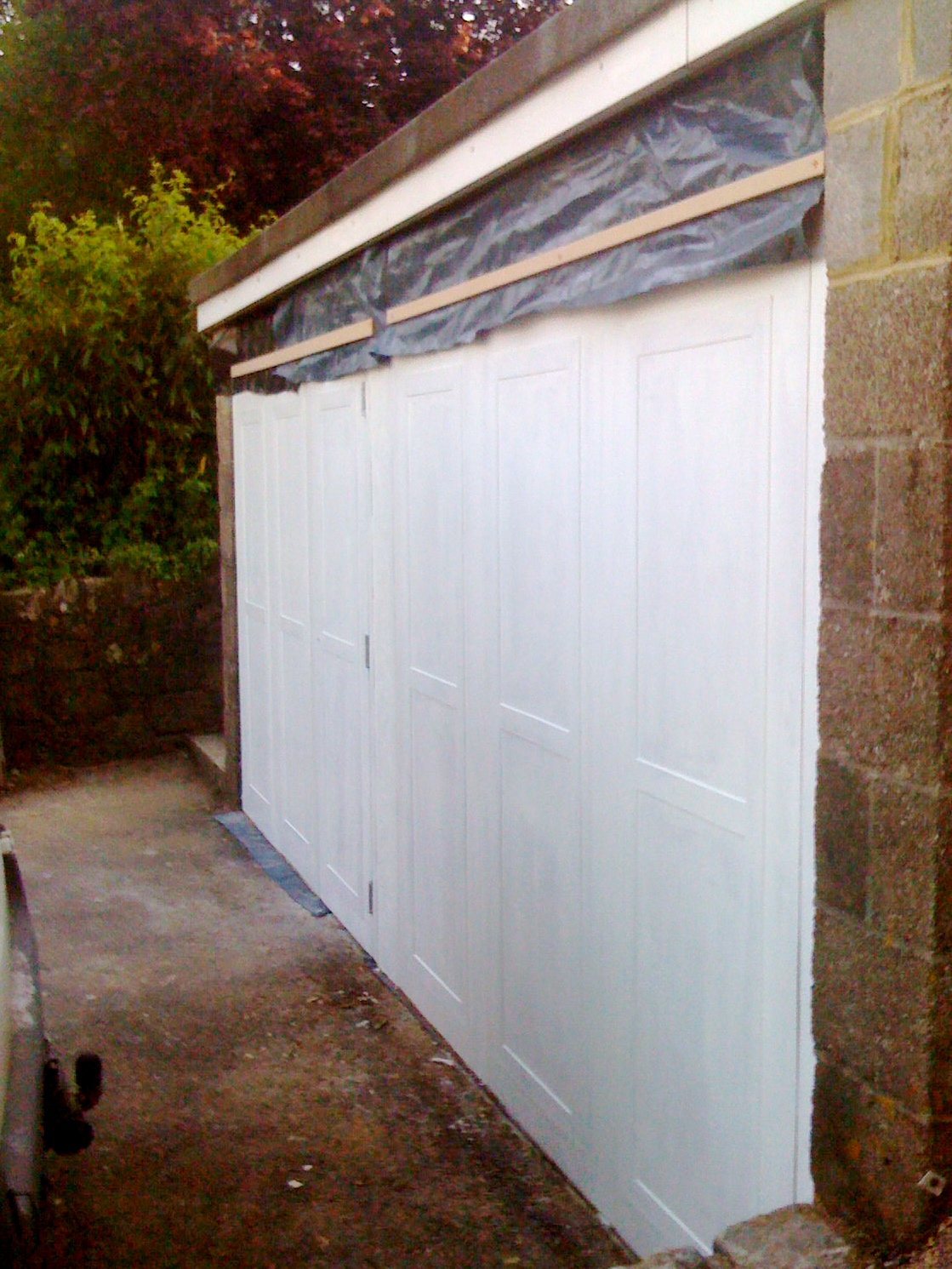 And here's the finished panels with the first coat of white Sadolin applied.