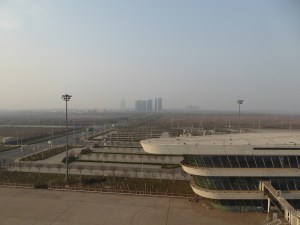 back to the ship at 4pm and look at the smog that has settled over the area (Beijing is over 200 miles away); that structure in the foreground is a wing of the terminal building