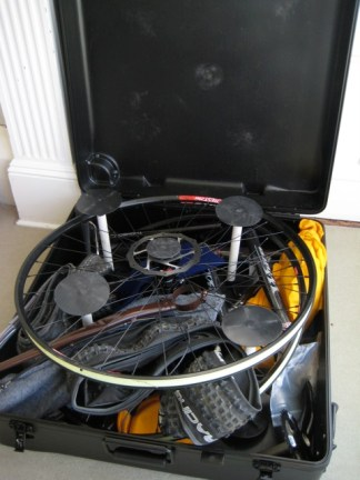 Packed in case, 29er tires must be removed