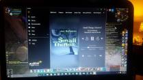 Crystal Robertson listening to Small Things audio book while playing World of Warcraft.