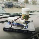 Kim Cameron's artfully arranged book, coffee, and glasses on a rainy day