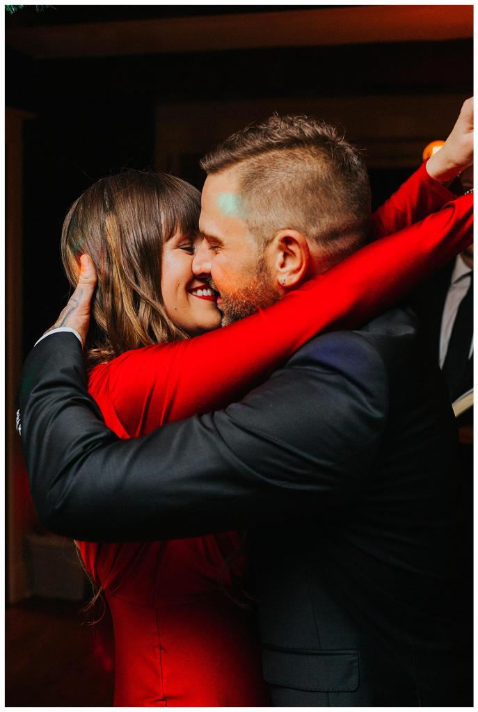 Bride and groom first kiss at their nontraditional Cambridge Christmas Elopement