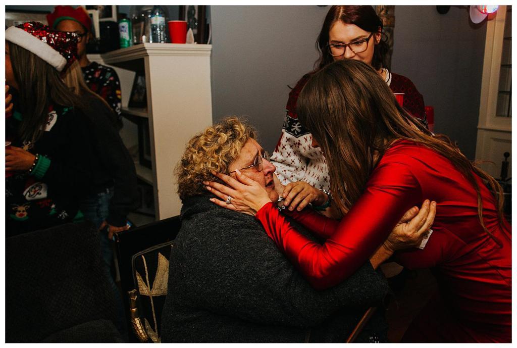 bride hugging a guest at a surprise elopement
