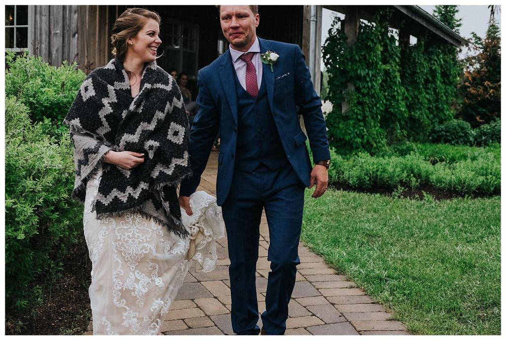 Bride and Groom walking in the rain | Rainy wedding photo ideas | Hanover Wedding | The Special Events Centre