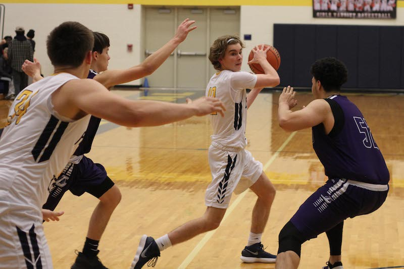 After 19-day break, Portage Central boys return to the basketball court with win vs. Battle Creek Lakeview