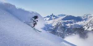 Ian Morrison skiing above Lakeside Bowl with Whistler Mountains Symphony Chair and the Black Tusk