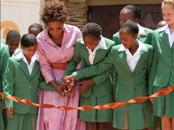 Oprah Winfrey and students cut the ribbon at the official opening of her Leadership Academy for Girls School at Henley-on-Klip, South Africa, Tuesday, Jan. 2, 2007