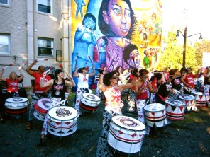 """""""A Survivor's Journey"""" inaugural event: the all-female percussion group Batala plays for the crowd."""