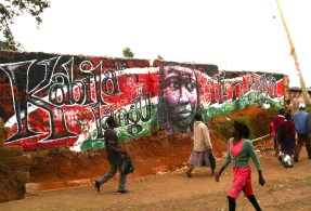 """Nairobi, Kenya 2013: """"Kabila Langu Ni Mkenya (My Tribe is Kenya)"""" is a statement against the destructive force of tribalism in Kenyan elections. Kibera Walls for Peace youth arts project in one of Africa's largest slums; working toward peace for the elections through public art and peace-building workshops with local youth."""