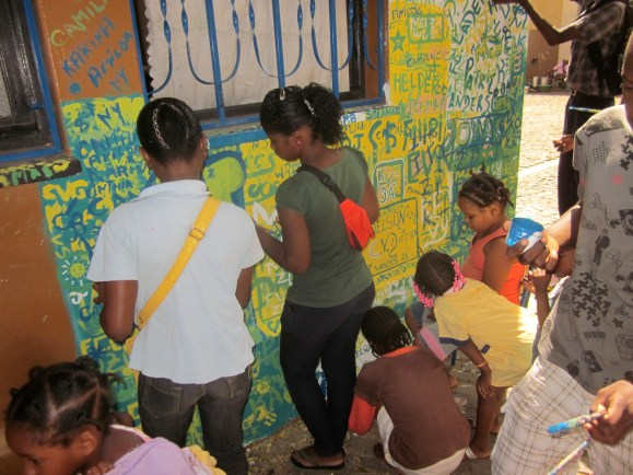 Students work on the mural in a school for troubled kids in the capital, Praia.